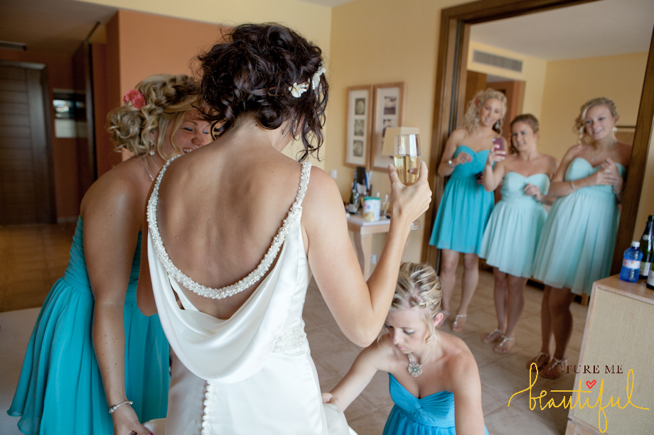 bridesmaid-dressing-the-bride-by-Picture-Me-Beautiful-Wedding-Photography