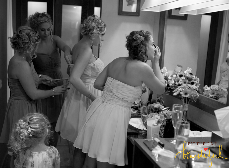 bridesmaids-getting-dressed-by-Picture-Me-Beautiful-Wedding-Photography