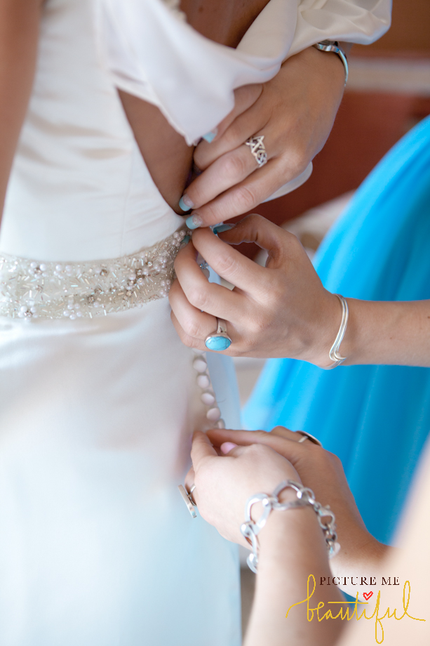 doing-up-the-wedding-dress-by-Picture-Me-Beautiful-Wedding-Photography