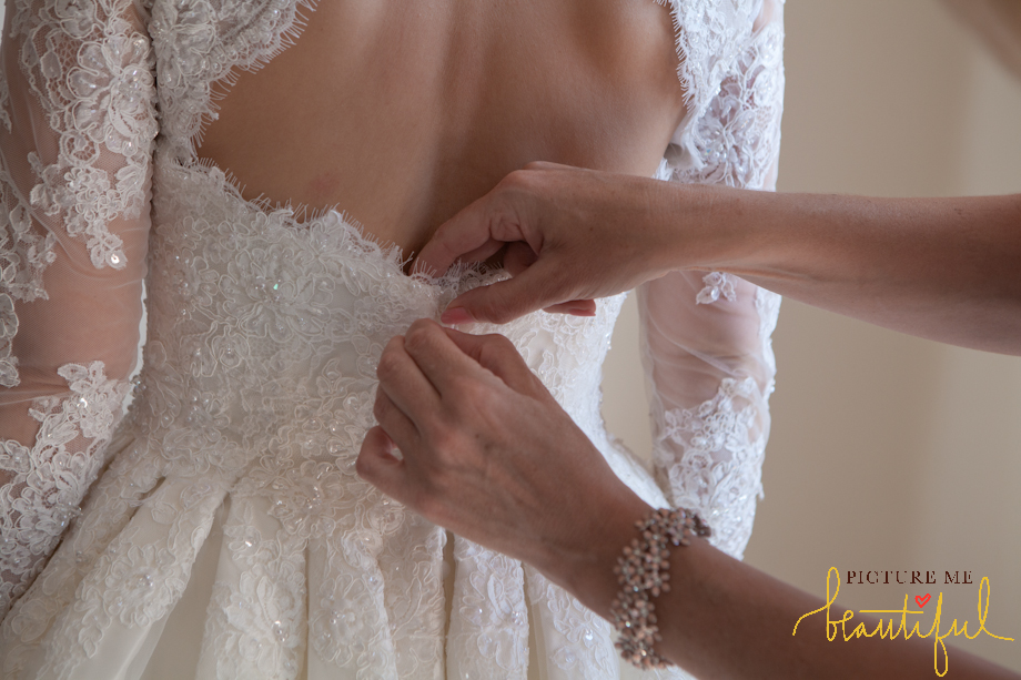 lace back detail in this gorgeous ellis bridal dress by  Picture Me Beautiful Wedding Photography and Film