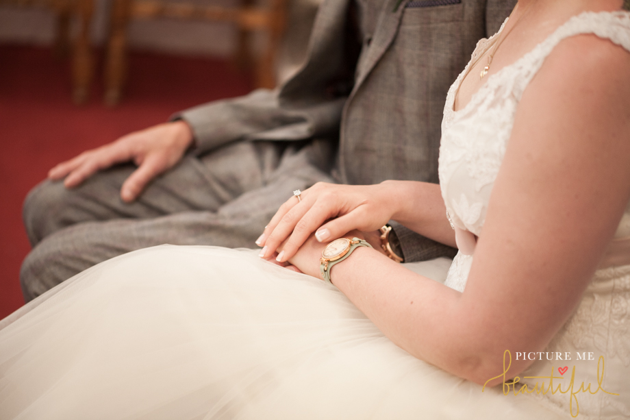 holding hands by Picture Me Beautiful Wedding Photography and Film