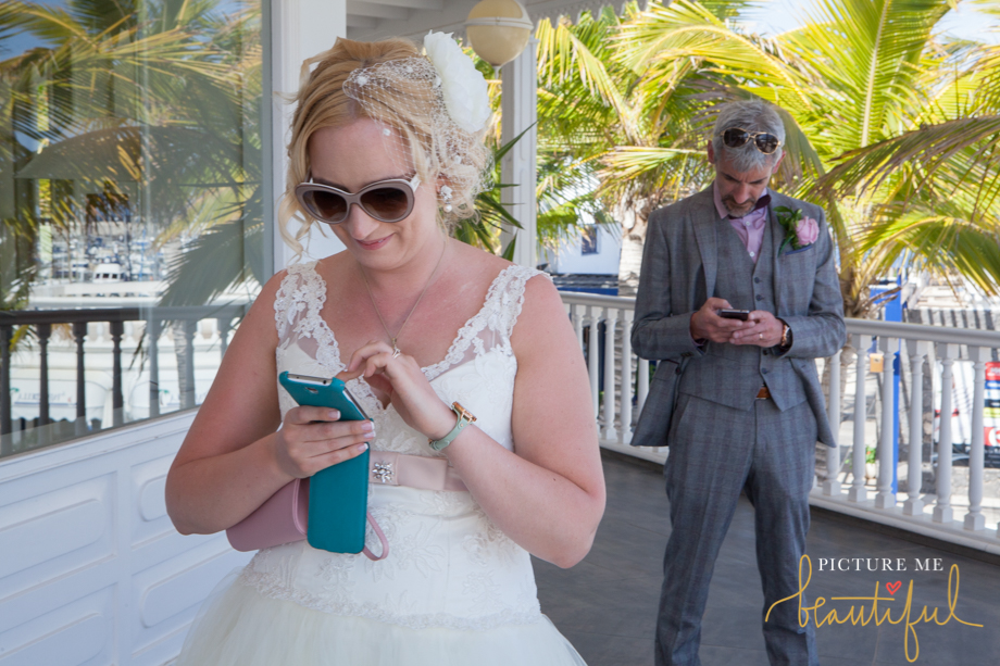 on the phone by Picture Me Beautiful Wedding Photography and Film